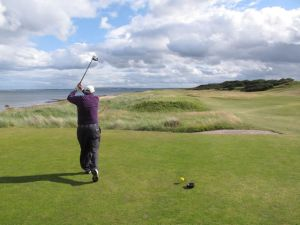 Golfer teeing off at Royal Dornoch