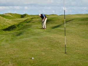 J Garrity putting at Askernish Old