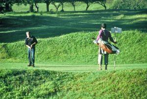 Srinagar golfer and caddie
